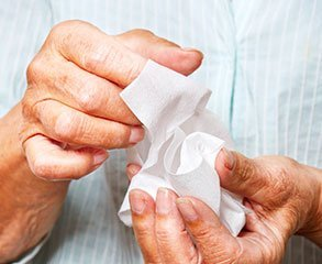 Cleansing wipes in hands